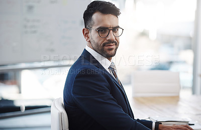 Buy stock photo Portrait of a young businessman sitting in an office
