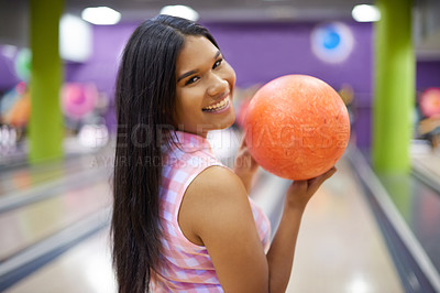 Buy stock photo Cropped shot of a beautiful young woman getting ready to bowl in a bowling alley
