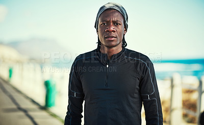 Buy stock photo Portrait of a sporty young man standing on the promenade