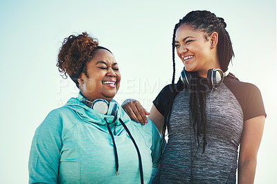 Buy stock photo Shot of two sporty young women standing together outdoors