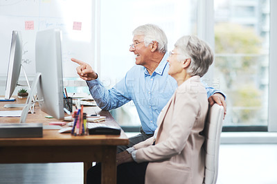 Buy stock photo Cropped shot of a senior couple working on their home finances in their study