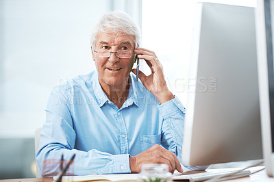 Buy stock photo Cropped shot of a handsome senior businessman making a phonecall while working in his office at home
