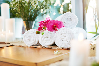 Buy stock photo Still life shot of flowers and towels on a table in a spa