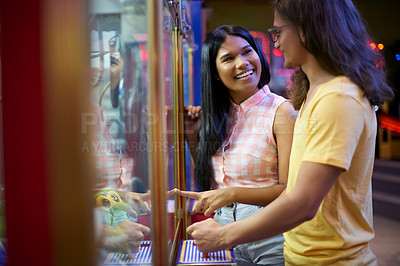 Buy stock photo Cropped shot of a beautiful young couple on a date in an arcade