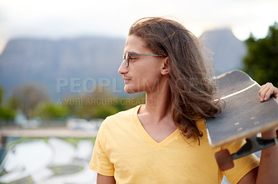 Buy stock photo Cropped shot of a handsome young man at a skatepark outside