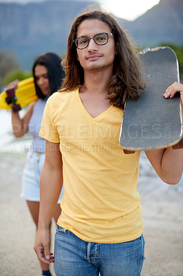 Buy stock photo Cropped shot of a beautiful young couple at a skatepark outside