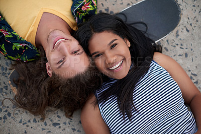 Buy stock photo High angle shot of a beautiful young couple at a skatepark outside