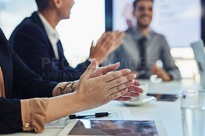 Buy stock photo Cropped shot of a group of businesspeople clapping during a meeting in a modern office