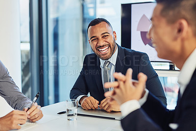 Buy stock photo Shot of a group of young businesspeople having a meeting in the boardroom of a modern office