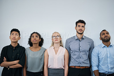 Buy stock photo Studio shot of a diverse group of businesspeople looking up against a grey background