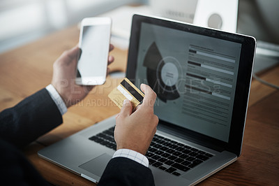Buy stock photo Closeup shot of an unrecognizable businessman using a cellphone and credit card in an office