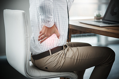 Buy stock photo Closeup shot of an unrecognizable businessman suffering with back pain while working in an office