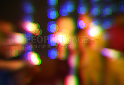 Buy stock photo Blurred shot of a group of unrecognizable friends having fun at a nightclub