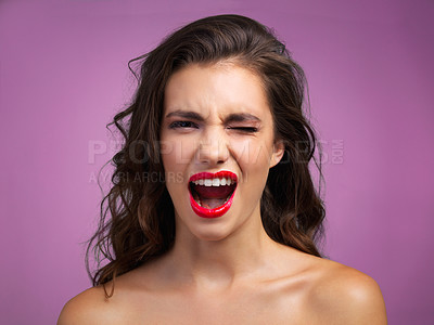Buy stock photo Studio portrait of a beautiful young woman screaming in anger against a purple background