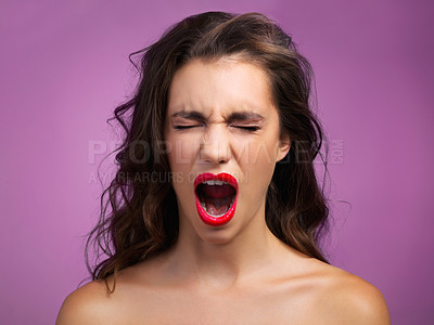 Buy stock photo Studio shot of a beautiful young woman screaming in anger against a purple background