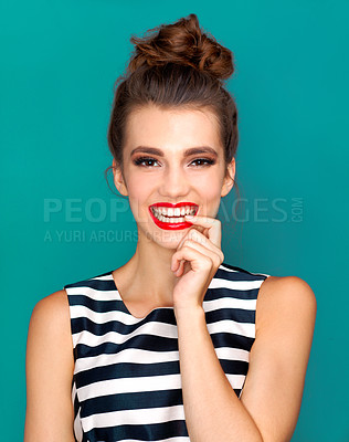 Buy stock photo Studio shot of a beautiful young woman posing against a turquoise background