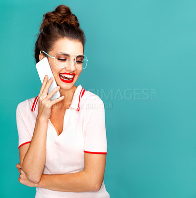 Buy stock photo Studio shot of a beautiful young woman talking on a cellphone against a turquoise background