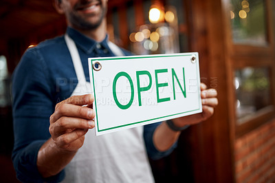 Buy stock photo Shot of a unrecognizable business owner holding up a sign saying