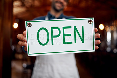 Buy stock photo Closeup of a unrecognizable business owner holding up a sign saying