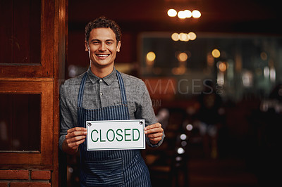 Buy stock photo Portrait of a cheerful young business owner holding up a sign saying