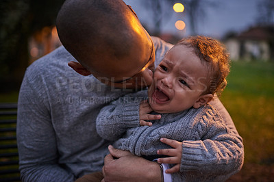 Buy stock photo Shot of a father comforting his crying son outdoors