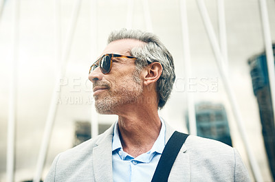 Buy stock photo Shot of a mature businessman out in the city