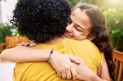 Buy stock photo Cropped shot of an adorable young girl and her mother embracing in the park