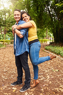 Buy stock photo Full length portrait of an affectionate young couple enjoying their day in the park