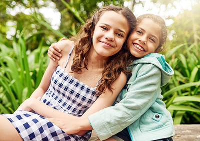 Buy stock photo Cropped portrait of two young sisters enjoying their day in the park
