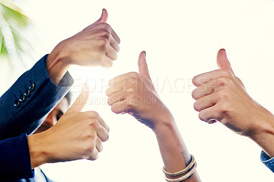 Buy stock photo Closeup shot of a group of unrecognizable businesspeople showing thumbs up together