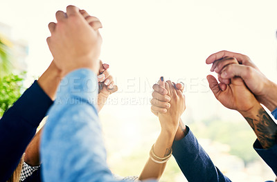 Buy stock photo Closeup shot of a group of unrecognizable businesspeople holding their hands in solidarity