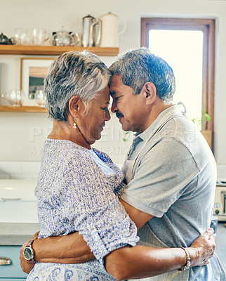 Buy stock photo Cropped shot of a mature couple dancing in the kitchen