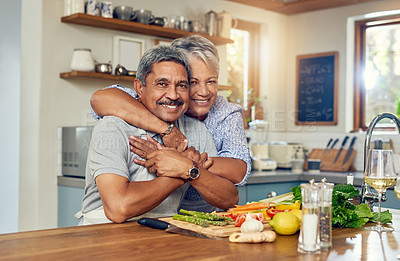 Buy stock photo Portrait of a happy mature couple cooking a meal together at home