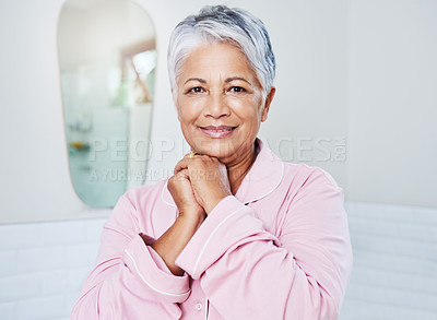 Buy stock photo Portrait of a cheerful mature woman holding her hands together while looking at the camera at home during the day