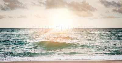 Buy stock photo Shot of a beautiful sunset over the ocean