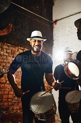 Buy stock photo Portrait of a young musical performer playing drums with his band