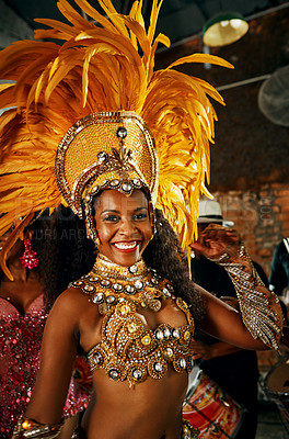 Buy stock photo Cropped portrait of a beautiful samba dancer performing in a carnival with her band