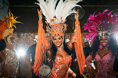 Buy stock photo Cropped shot of three beautiful samba dancers performing in a carnival with their band