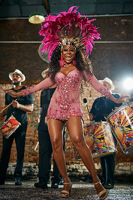 Buy stock photo Full length portrait of a beautiful samba dancer performing in a carnival with her band