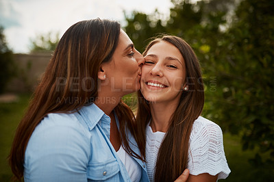 Buy stock photo Cropped shot of a young woman kissing her young daughter on the cheek