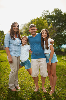 Buy stock photo Full length portrait of a young family of four standing outside