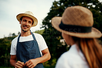 Buy stock photo Cropped shot of a handsome man talking to his young daughter while working on their farm
