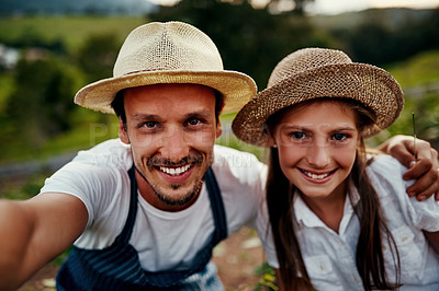 Buy stock photo Cropped portrait of a handsome man and his young daughter taking selfies while working on their farm