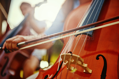 Buy stock photo Cropped shot of an unrecognizable woman playing a cello outdoors