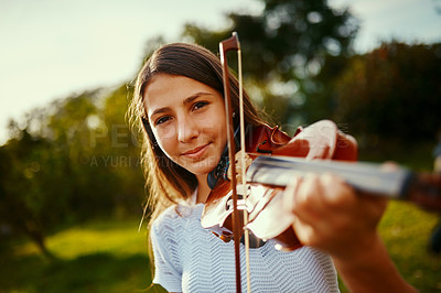 Buy stock photo Cropped shot of a young girl playing a violin outdoors