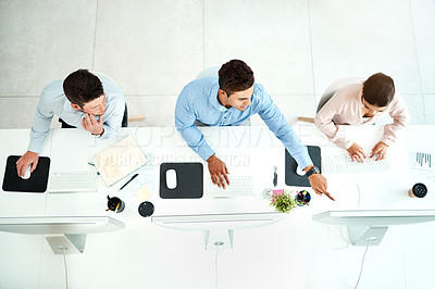 Buy stock photo High angle shot of a team of young agents working in a call centre