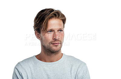 Buy stock photo Studio shot of a handsome young man standing against a white background