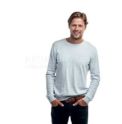 Buy stock photo Studio portrait of a handsome young man standing with his hands in his pockets against a white background