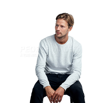 Buy stock photo Studio shot of a handsome young man sitting against a white background