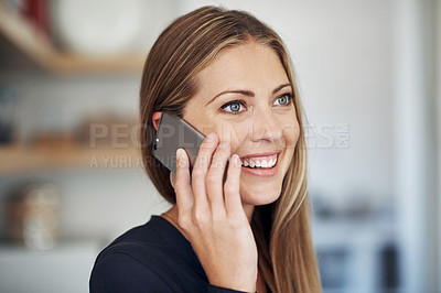 Buy stock photo Shot of an attractive young woman using a mobile phone at home